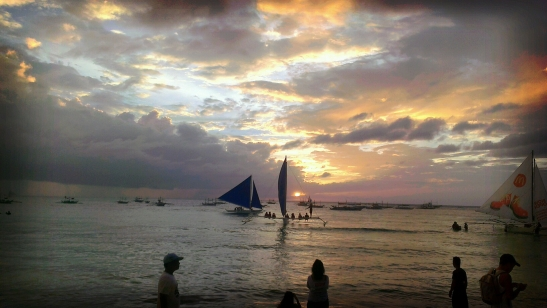 Boats sailing at sunset in Boracay