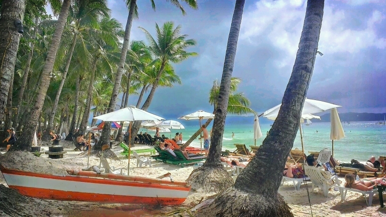 Partly cloudy, partly sunny day at the white beach Boracay