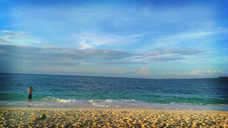 A lonesome swimmer at Puka Beach, Boracay