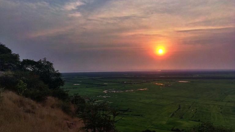 Sunset view on top of Wat Knang Phnom Krom overlooking rice fields