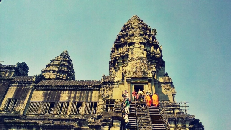 Monks and visitors alike ascending/descending the Angkor Wat temple