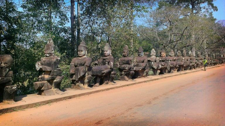 Row of Buddhas at the entrance of Angkor Thom