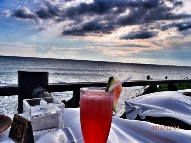 Having fresh fruit juice overlooking the Indian Ocean in Bali