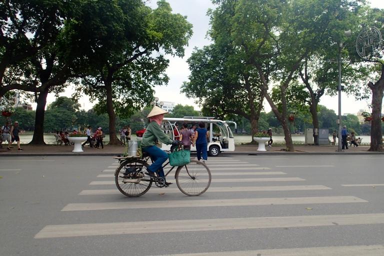 Vietnamese woman biking along Dinh Thien Hoang street