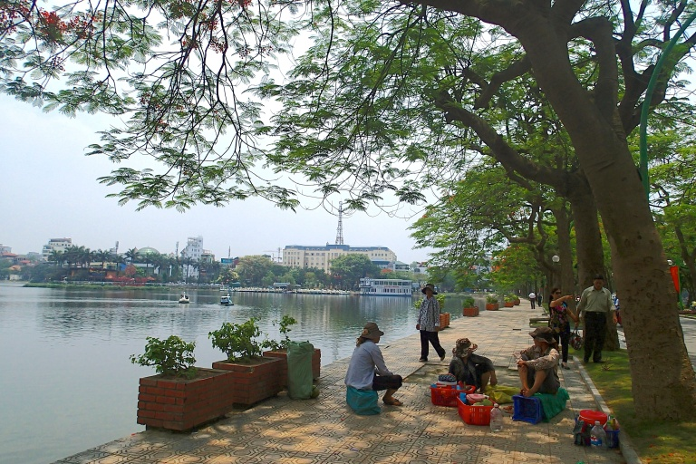Vendors sitting by the Truc Bach Lake