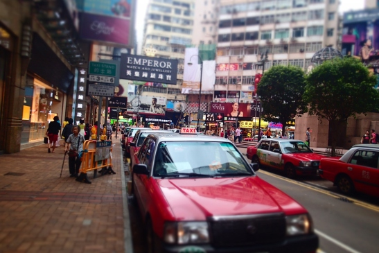 Red taxis queueing in Times Square, Hong Kong