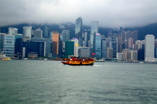 Boat sailing in Victoria harbour in Hong Kong