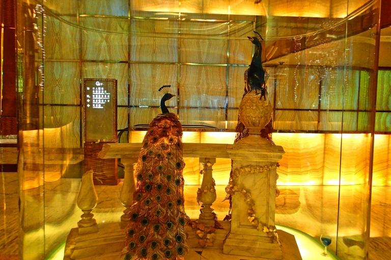 A life-sized gold peacock display at Lisboa Hotel